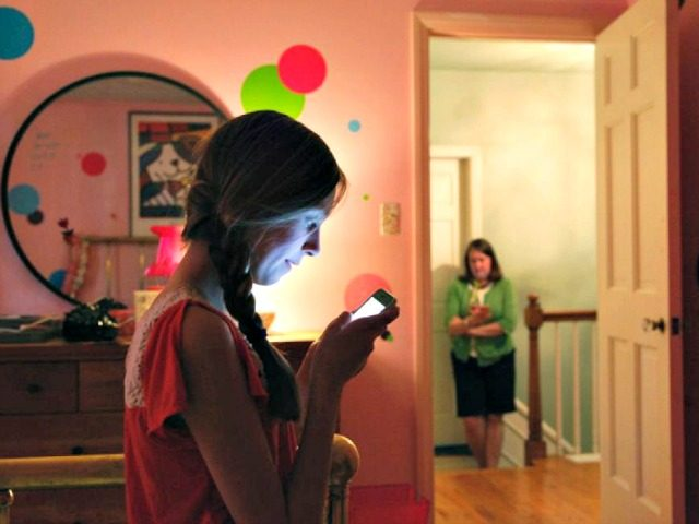 Young Girl on Cell Phone CHARLES REX ARBOGASTAP