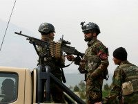 Afghan military soldiers stand stand alert at the entrance gate of the new parliament building after a rocket attack in Kabul, Afghanistan, Monday, March 28, 2016. The Taliban claimed responsibility for firing a series of rockets at Kabul's new parliament building early on Monday. No casualties were reported. (AP Photo/Rahmat …