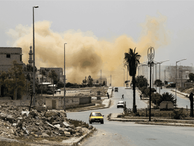 Smoke is seeing rising on a main road in the Salihin neighbourhood of Syria's northern city of Aleppo following a reported air strike on April 24, 2016.