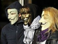 People wearing Guy Fawkes masks demonstrate prior to the trial of three 'Anonymous' for their alleged involvement in cyber attacks targetting institutional websites, on November 9, 2015 in front of Nancy's courthouse, eastern France.
