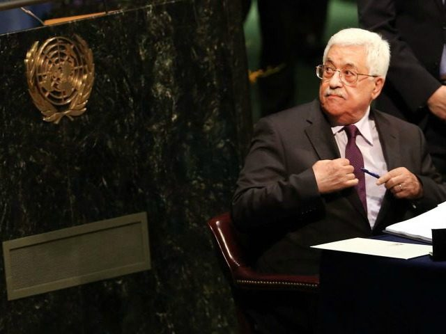 Palestinian President Mahmoud Abbas signs the Paris Agreement on climate change at the UN on April 22, 2016 in New York City. Spencer Platt / Getty Images / AFP