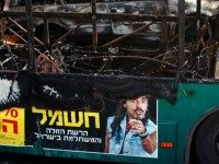general view shows the remains of a bus following a bomb blast on board in Jerusalem on April 18, 2016.