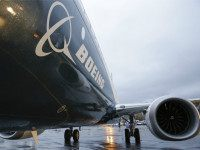 Boeing's first 737 MAX, named the 'Spirit of Renton,' sits on the tarmac Dec. 8 at the Boeing factory in Renton, Washington. Boeing aircraft orders fell by nearly half in 2015 even as deliveries rose to a record, the aerospace giant said Thursday. Boeing said that net orders for new aircraft dropped to 768 last year from 1,432 in 2014, putting it behind rival Airbus, which is expected to report well over 1,000 orders for last year. | AFP-JIJI