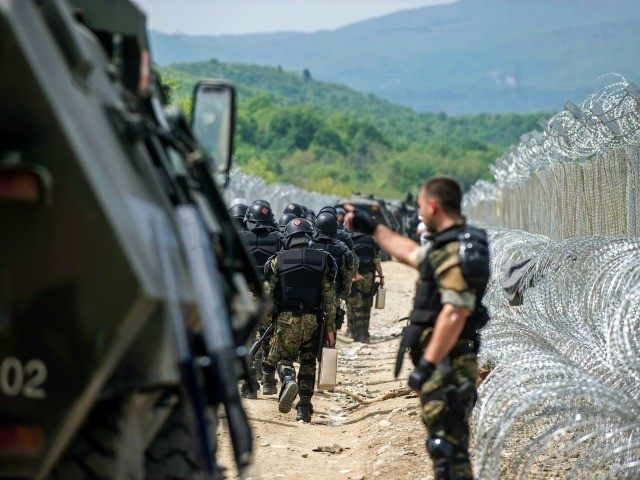 Macedonian police deploy their forces near the razor wire fence at Greek-Macedonian border near Gevgelija, on April 13, 2016.
