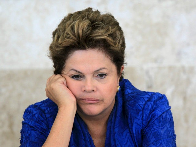 Brazil's President Dilma Rousseff attends the launching ceremony of sectoral plans for the mitigation of climate change at the meeting of the Brazilian Forum on Climate Change in Brasilia, June 5, 2013. REUTERS/Ueslei Marcelino