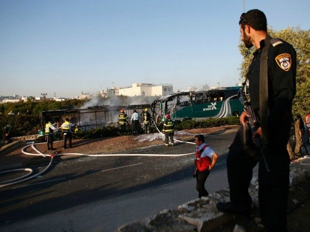 Israeli forensic and firefighters work at the scene of an explosion on a bus in Jerusalem on April 18, 2016.