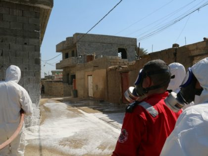 Members of the civil defence spray and clean areas in the town of Taza, around 220 kilometres north of the capital Baghdad, on March 13, 2016, that might have been contaminated in a chemical attack carried out by the Islamic State (IS) group the previous week.