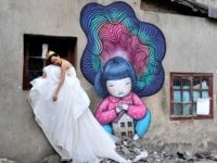 A China bride poses for wedding photos at Kangding Road where old houses are demolished on January 22, 2015 in Shanghai, China.