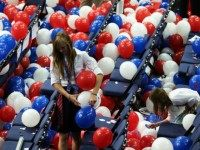 A person stands in balloons during the final day of the Republican National Convention at the Tampa Bay Times Forum on August 30, 2012 in Tampa, Florida.