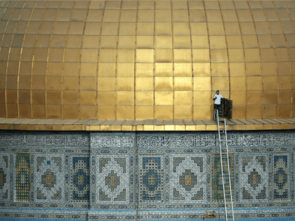 A Palestinian man stands by a door at the golden dome of the Dome of the Rock mosque on the Al-Aqsa mosque compound, in Jerusalem's Old City, on September 29, 2015.