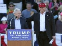 Republican presidential candidate Donald Trump, right, stands next to Sen. Jeff Sessions, R-Ala., as Sessions speaks during a rally Sunday, Feb. 28, 2016, in Madison, Ala. (AP Photo/John Bazemore)