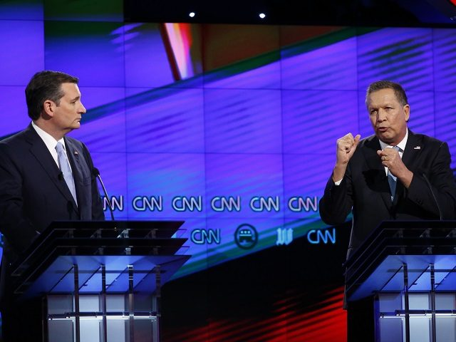 Republican presidential candidate, Ohio Gov. John Kasich, right, speaks as Republican presidential candidate, Sen. Ted Cruz, R-Texas, listens, during the Republican presidential debate sponsored by CNN, Salem Media Group and the Washington Times at the University of Miami, Thursday, March 10, 2016, in Coral Gables, Fla. (AP Photo/Wilfredo Lee)