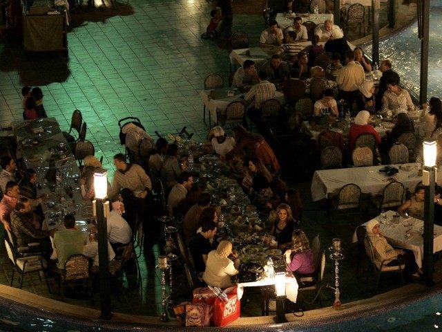 Friday night diners gather in the outdoor area of the Damascus Gate, the world's largest restaurant, in Damascus on June 13, 2008. At 54,000 sq-m, with a 2,500 sq-m kitchen catering for up to 6014 guests Damascus Gate has taken the acolade of the largest restaurant in the world.