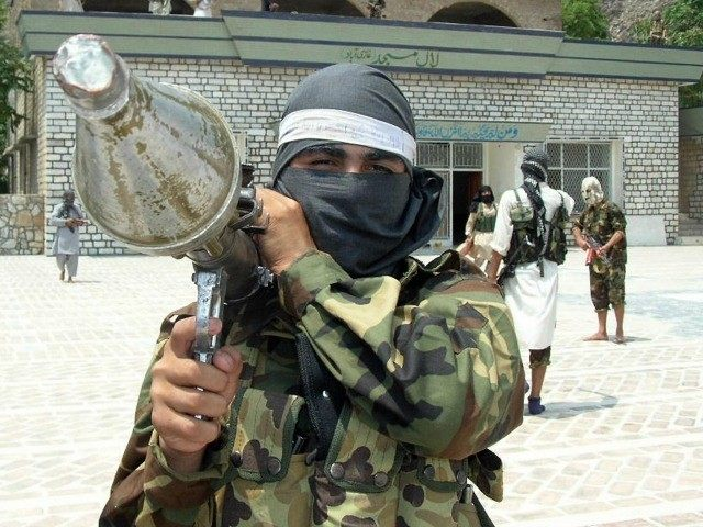 A Pakistani pro-Taliban militant carries rocket propelled granade launcher (RPG) as he stands inside the shrine in Lakaro village in the lawless Mohmand tribal district bordering Afghanistan, some 60 kilometers (37 miles) northwest of Peshawar, 30 July 2007.