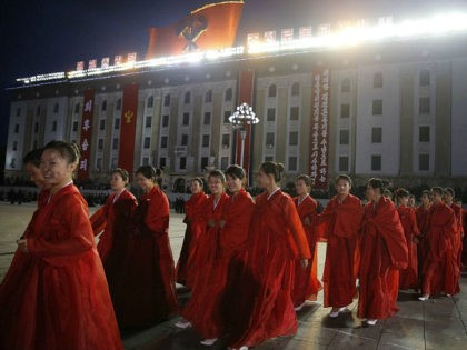 PYONGYANG, NORTH KOREA - OCTOBER 10: (CHINA OUT) Girls dressed in festival costumes to celebrate the 70th founding anniversary of the DPRK's ruling Workers' Party of Korea (WPK) on October 10, 2015 in Pyongyang, North Korea. (Photo by Liu Xingzhe/ChinaFotoPress/ChinaFotoPress via Getty Images)