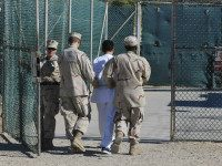 US Navy guards escort a detainee through Camp Delta, June 10, 2008. REUTERS/DOD/1ST LT. SARAH CLEVELAND
