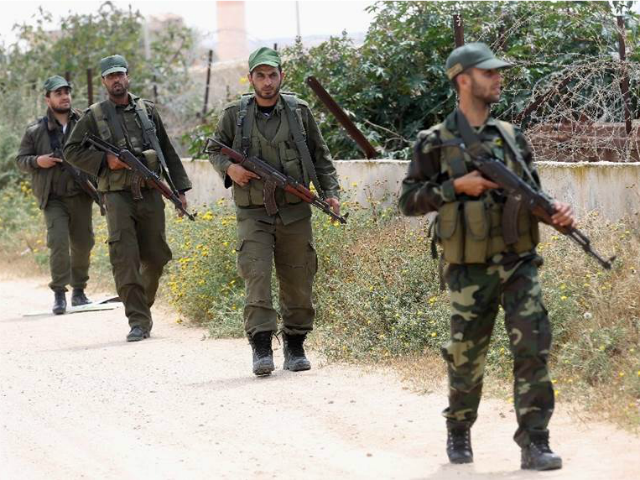 Hamas security forces patrol an area along the border between the Gaza Strip and Egypt on April 14, 2016 in Rafah