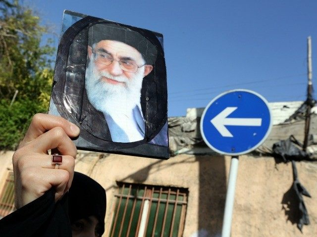An Iranian woman holds a portrait of Iran's supreme leader Ayatollah Ali Khamenei duringa demonstration against the Saudi-led coalitions Operation Decisive Storm against the Huthi rebels in Yemen, outside the Saudi embassy in Tehran on April 13, 2015.