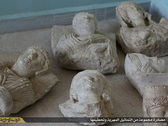 SYRIA, MANBIJ : An image made available by propaganda Islamist media outlet Welayat Halab on July 2, 2015 allegedly shows ancient artifacts smuggled from the Syrian city of Palmyra, a 2,000-year-old metropolis and an Unesco world heritage site located 215 kilometres northeast of Damascus, before they were destroyed by Islamic State (IS) group fighters in the town of Manbij, northeast of Syria's embattled northern town of Aleppo. AFP PHOTO / HO / WELAYAT HALAB