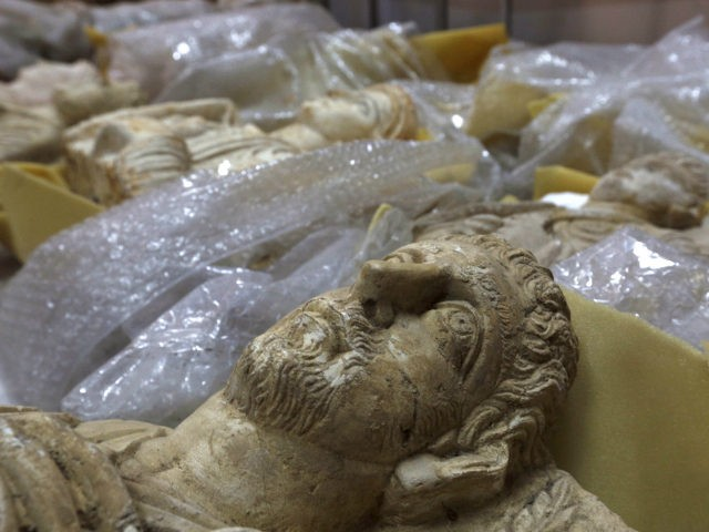 Antiquities are unwrapped as thousands of priceless antiques from across war-ravaged Syria are gathered in the capital to be stored safely away from the hands of Islamic State militants and the ongoing war across most of the country, in Damascus, Syria August 18, 2015. REUTERS/OMAR SANADIKI