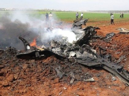 A general view shows the wreckage of a government warplane after Al-Nusra front (Al-Qaeda's Syria affiliate) reportedly shot it down over the northern Syrian town of Al-Eis on April 5, 2016 and captured one crew member alive, a rebel source and the Syrian Observatory for Human Rights said.