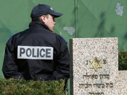 A policeman stands 02 April 2007 in the Jewish cemetery in the northern French city of Lille, where 50 gravestones have been desecrated in an overnight attack 31 March 2007.