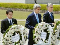 From left, Japan's Foreign Minister Fumio Kishida, U.S. Secretary of State John Kerry and Britain's Foreign Minister Philip Hammond carry wreath to offer at the cenotaph at Hiroshima Peace Memorial Park in Hiroshima, western Japan Monday, April 11, 2016. (Kyodo News via AP) JAPAN OUT, MANDATORY CREDIT