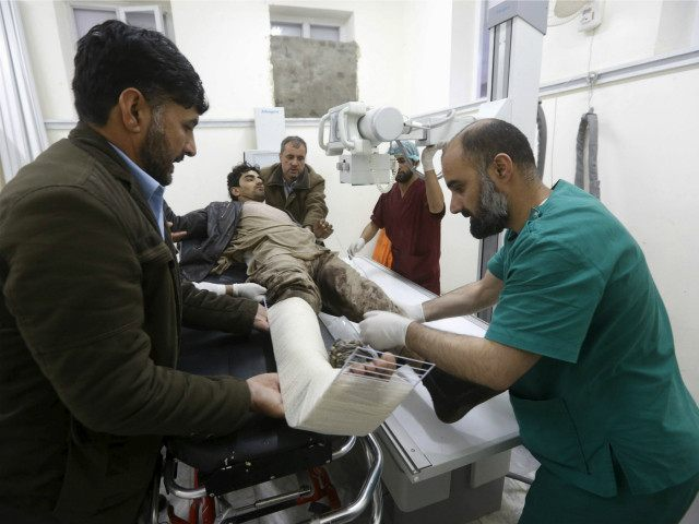 An Afghan man receives treatment at a hospital after a suicide car bomb attack in Kabul, Afghanistan April 19, 2016. REUTERS