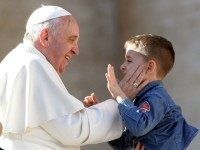Pope Francis greets a boy as he attends a meeting with engaged couples from all over the world gathered today, on the feast of St. Valentine, in St. Peter's Square February 14, 2014 in Vatican City, Vatican.