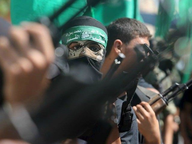 Palestinian Hamas militants take part in a protest against the Israeli police raid on Jerusalem's al-Aksa mosque in Khan Yunis. (photo credit:REUTERS)