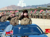This undated picture released from North Korea's official Korean Central News Agency (KCNA) on March 25, 2016, shows North Korean leader Kim Jong-Un (front R) inspecting the large-scale intensive striking drill of long-range artillery pieces of the KPA large combined units at an undisclosed location in North Korea. / AFP …