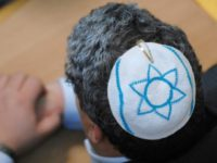A member of the Jewish community, wearing a kippa, attends the inauguration of the new synagoge of Bochum, western Germany, also attended by the President of the Central Council of Jews in Germany Charlotte Knobloch and Northrhine-Westphalia State Premier Juergen Ruettgers, 16 December 2007.