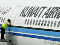 A ground crewmember takes a peek inside the cabin of a Kuwait Airways Airbus A340 at the Kuala Lumpur International Airport in Sepang, 01 November 2006.