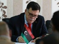 LIBYA, Tripoli : Libya's Prime minister-designate Fayez al-Sarraj chairs a Presidential Council of the Government of National Reconciliation meeting with local mayors inside the naval base in the Libyan capital Tripoli on April 3, 2016. / AFP / MAHMUD TURKIA