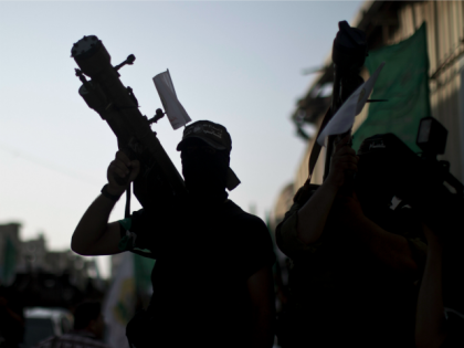 A silhouette of a Palestinian militant from the Ezzedine al-Qassam brigade, the armed wing of Hamas, carries a Man Portable Air Defence System (MANPAD) during a march in Gaza City on September 14, 2013.