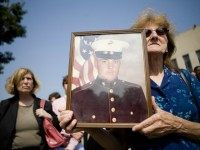 Edwin Marian Johnston hold up a photo of her son US Marine CPL Edward Johnston who died in the bombing of his Lebanon barracks in 1983 outside Federal Court September 7, 2007 in Washington, DC.