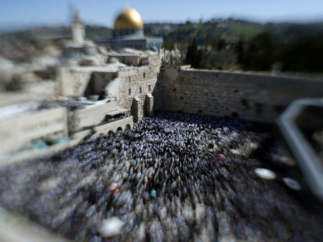 A picture taken with a tilt-shift lens shows a general view of Jewish men draped in prayer shawls perform the Cohanim prayer (priest's blessing) during the Pesach (Passover) holiday at the Western Wall in the Old City of Jerusalem on April 6, 2015.