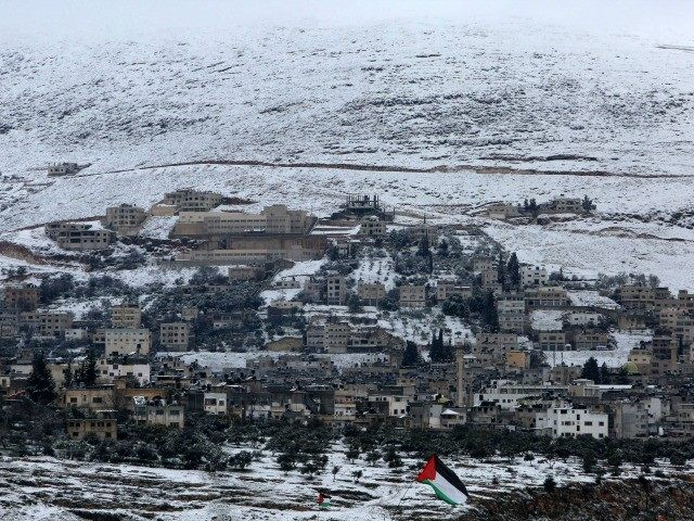Snow covers the mountain side in the West Bank city of Nablus on February 20, 2015, following heavy snow fall.