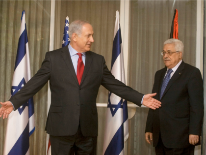 U.S. Secretary of State Hillary Clinton, Israeli Prime Minister Benjamin Netanyahu and President of the Palestinian Authority Mahmoud Abbas meet at Netanyahu's residence September 15, 2010 in Jerusalem, Israel.