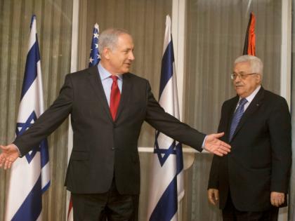 U.S. Secretary of State Hillary Clinton, Israeli Prime Minister Benjamin Netanyahu and President of the Palestinian Authority Mahmoud Abbas meet at Netanyahu's residence September 15, 2010 in Jerusalem, Israel.