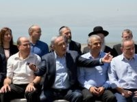 Israeli Prime Minister Benjamin Netanyahu (C) poses with ministers prior to the weekly cabinet meeting in the Israeli-annexed Golan Heights on April 17, 2016.