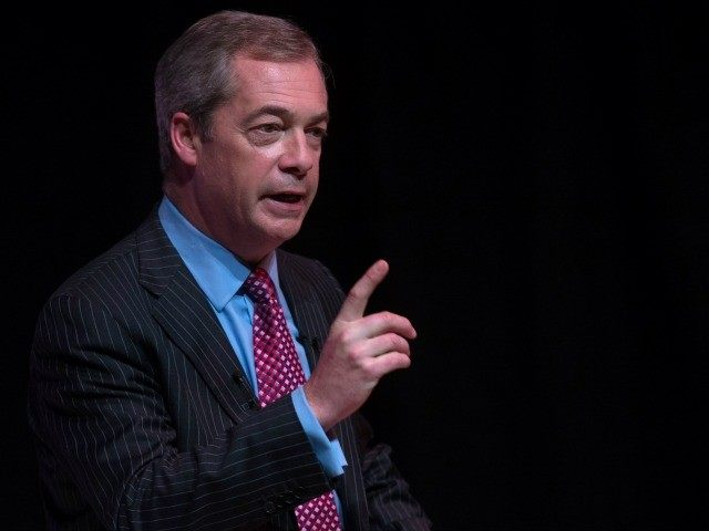 BASINGSTOKE, ENGLAND - NOVEMBER 16: The audience applauds as UKIP leader Nigel Farage addresses supporters at a 'Say No To Europe' meeting at the Anvil on November 16, 2015 in Basingstoke, England. The right-wing Eurosceptic used his speech supporting a British exit from the European Union to also claim British …