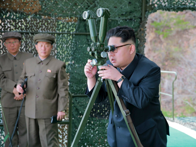 DEMOCRATIC PEOPLE'S REPUBLIC OF KOREA : This picture released from North Korea's official Korean Central News Agency (KCNA) on April 24, 2016 shows North Korean leader Kim Jong-Un (R) inspecting an underwater test-fire of a strategic submarine ballistic missile at an undisclosed location in North Korea on April 23, 2016. …