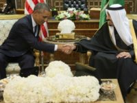 Saudi's newly appointed King Salman (R) shakes hands with US President Barack Obama at Erga Palace in Riyadh on January 27, 2015.