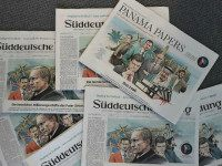 "GERMANY, Munich : TOPSHOT - A photo taken on April 7, 2016 in Munich, southern Germany, at the office of the German daily ""Sueddeutsche Zeitung"" shows several issues of the newspaper dated April 4, 2016, titling on the socalled ""Panama Papers"" with illustrations by German artist Peter M Hoffmann depicting heads of state. The Panama Papers are a massive leak of 11.5 million documents allegedly exposing the secret offshore dealings of aides to Russian president Vladimir Putin, world leaders and celebrities including Barcelona striker Lionel Messi. The vast stash of records was obtained from an anonymous source by German daily Sueddeutsche Zeitung and shared with media worldwide by the International Consortium of Investigative Journalists (ICIJ)."