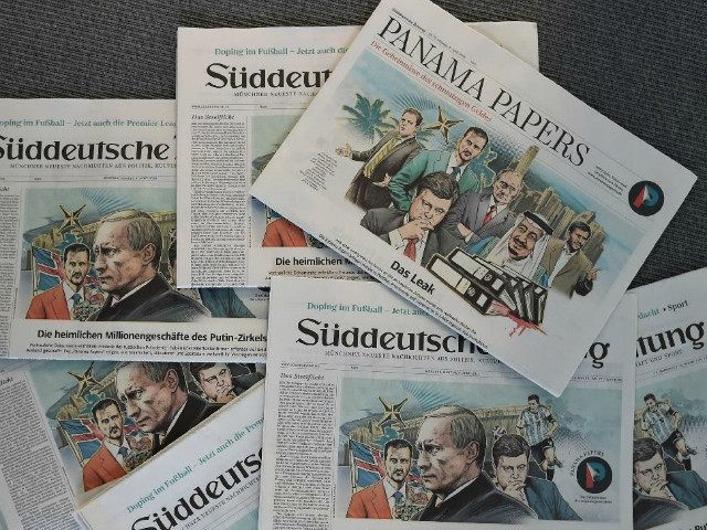 "GERMANY, Munich : TOPSHOT - A photo taken on April 7, 2016 in Munich, southern Germany, at the office of the German daily ""Sueddeutsche Zeitung"" shows several issues of the newspaper dated April 4, 2016, titling on the socalled ""Panama Papers"" with illustrations by German artist Peter M Hoffmann depicting …"