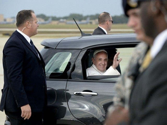 Pope Francis departs in a Fiat after arriving from Cuba to the United States September 22, 2015 at Joint Base Andrews, Maryland.