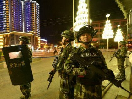 Armed Chinese paramilitary policemen stand guard on a road in Kashgar, northwest China's Xinjiang Uygur Autonomous Region, 2 September 2015.(Imaginechina via AP Images)