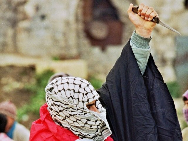 A Palestinian youth shown in a file photo dated 21 February 1988 with a Palestinian flag wrapped around him and a knife in his hand, waiting for Israeli soldiers to arrive at a spot in the Old City of Nablus where a crowd of angry Palestinians started gathering following the …