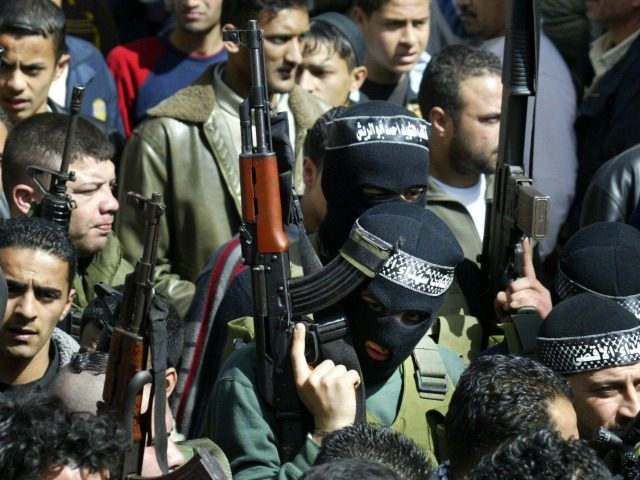 Gunmen take part in the funeral of four of the fivePalestinians killed during yesterday's Israeli army incursion into the Balata refugee camp, in the West Bank city of Nablus 24 February.